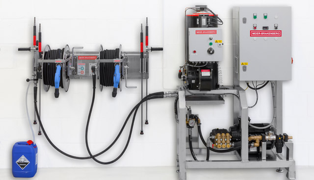 Frequency controlled high-pressure aggregate for up to 3,000 l/h or 4,200  l/h and integrated hot-water unit MBHot, infinitely variable up to 90° C. The illustrated operating panel includes hose reels for two simultaneously working users. Therefore it is possible to place the pump unit inside the equipment room and the hose panel at the washing area.