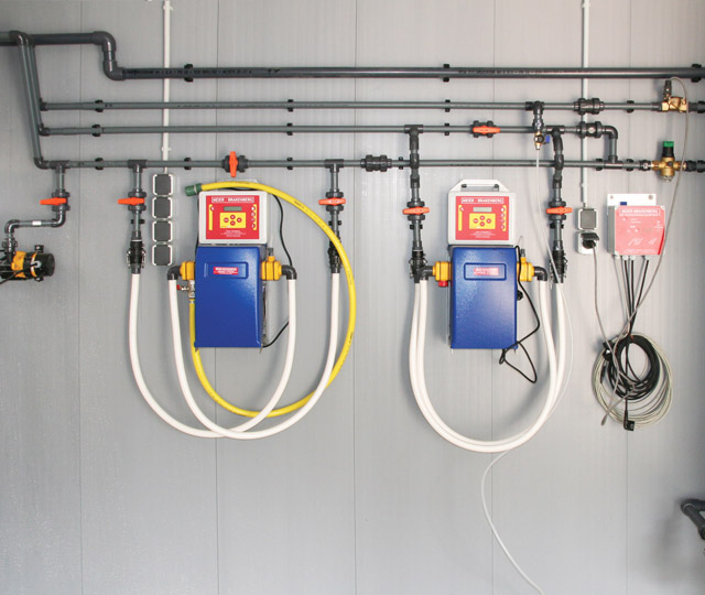 Water distribution inside pigsty with two permanently integrated electrical medication dosing systems - both with MBDos1. This arrangement facilitates parallel dosing of acids and medication into the drinking wate