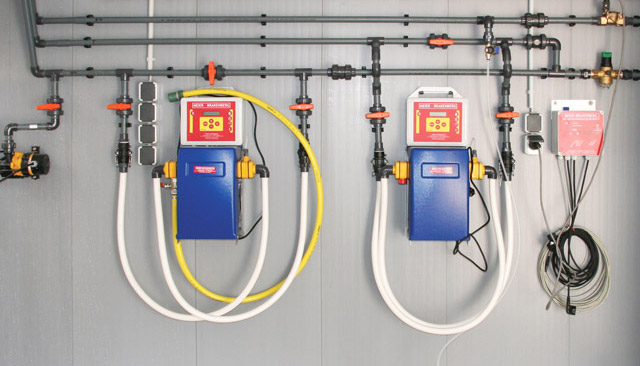 Water distribution inside pigsty with two permanently integrated electrical medication dosing systems - both with MBDos1. This arrangement facilitates parallel dosing of acids and medication into the drinking water.